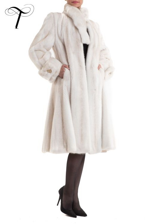 Toutountzis Furs | #MINKCOAT   This stunning #coat, is the epitome of #elegance and #sophistication. Crafted from pearl,#mink #fur, it features a long funnel neck collar adorned with a stylish button and matching cuffs. It is tailored closely to the figure with a fitted waist and has a plush swing skirt. Complete with concealed hook and eye fastenings, slit pockets and #satin lining, it will be the ultimate finishing touch to your evening appearance.