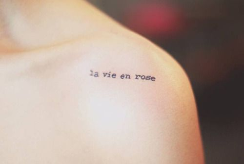 Shoulder tattoo saying La vie en rose by Seoeon....