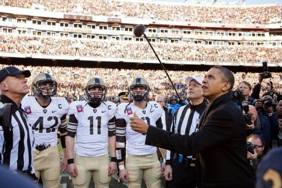 President Barack Obama performs the coin toss before the annual Army vs. Navy football game at FedEx Field in Landover, Md., Saturday, December 10, 2011.