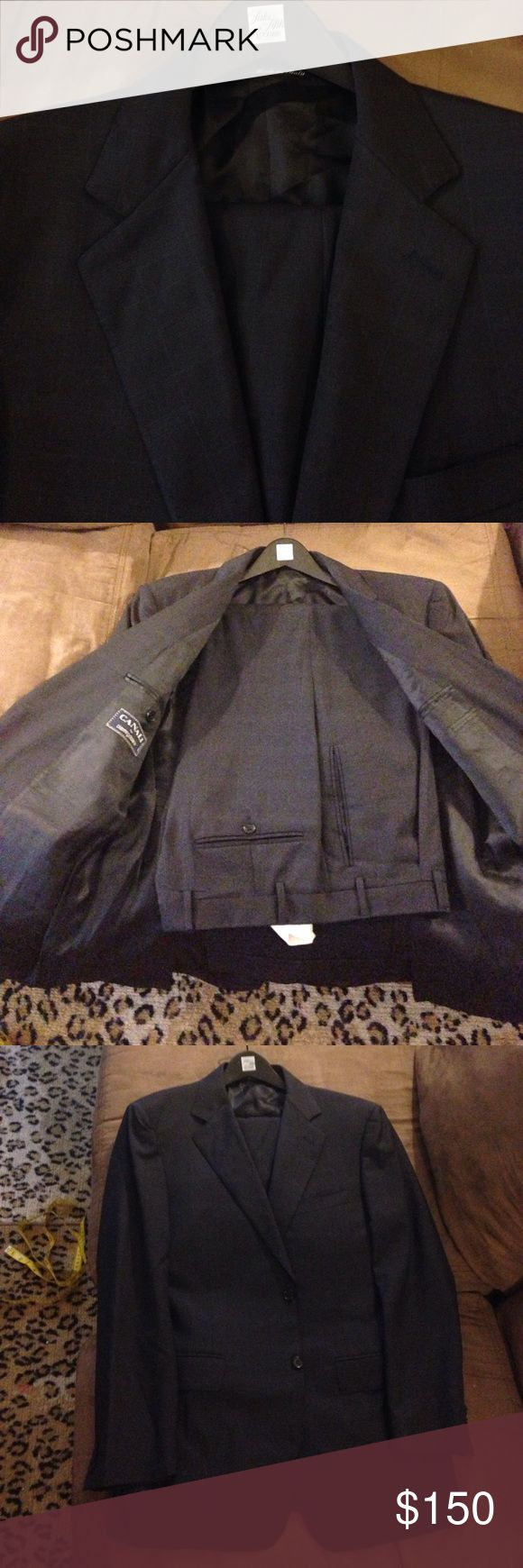 Canali Navy Blue Plaid Suit size 38R Canali Navy Blue with Blue and Grey Plaid Suit size 38R Regular, 2 Button and Double Vented! Pants are a size 32x31, Pleated and cuffed! Like new! Please make REASONABLE offers and bundle to save! Canali Suits & Blazers Suits