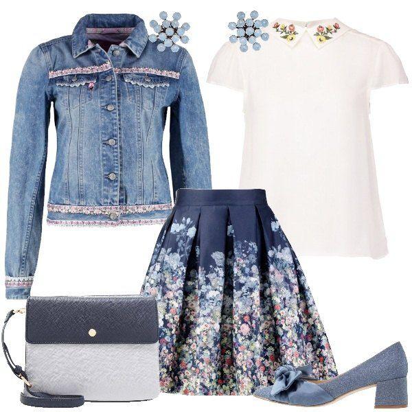 Total look dedicato alla donna delicata e romantica. L' outfit è composto da giacca di jeans blue e rosa con collo classico, gonna a campana a fantasia floreale in cotone e camicia white con colletto classico. Completo il look con una décolleté blue a punta con fiocco, una borsa tracolla blue e grey e un paio di orecchini light blue in metallo.