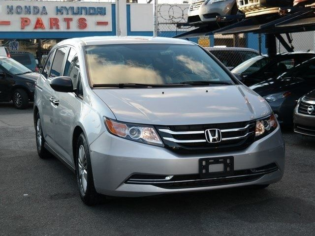 2014 Honda Odyssey 5dr LX for sale at Plaza Auto Leasing https://www.plazaautoleasing.com/pre-owned-vehicles.cfm
