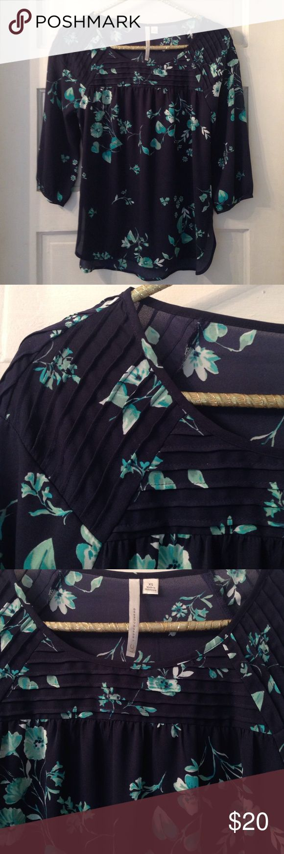 LC Lauren Conrad beautiful floral blouse- navy This shirt is gorgeous! Blue, floral, elbow length sleeves. Like-new. 💙💙💙 LC Lauren Conrad Tops Blouses