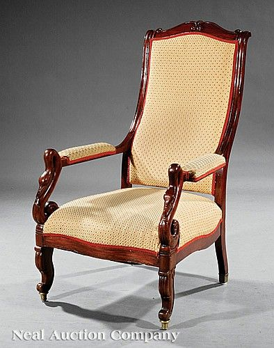 An American Classical Carved Mahogany Chaise Voltaire, early 19th c., New York, arched crest, padded arms on swan supports, lappet legs, brass ferrules