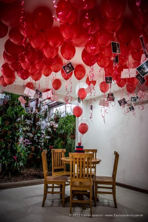 I wouldn't do this for valentines but what a cute idea for a party with photos hanging from balloons!