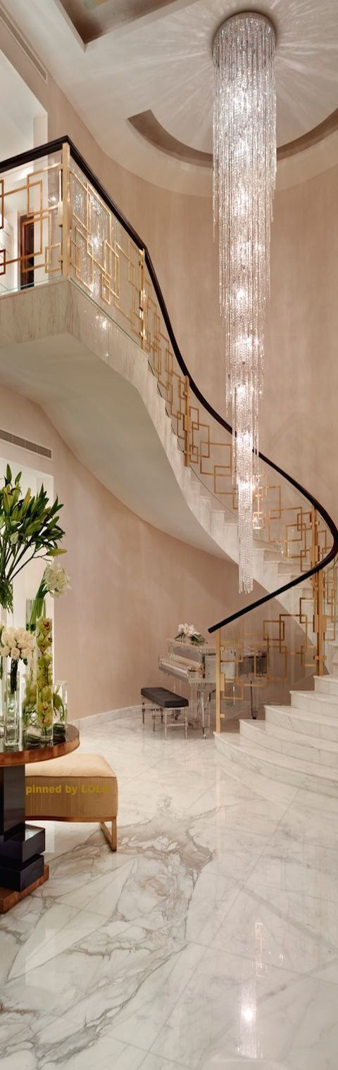 Focus: Chandelier and stair railings.  By Priory Home Atelier