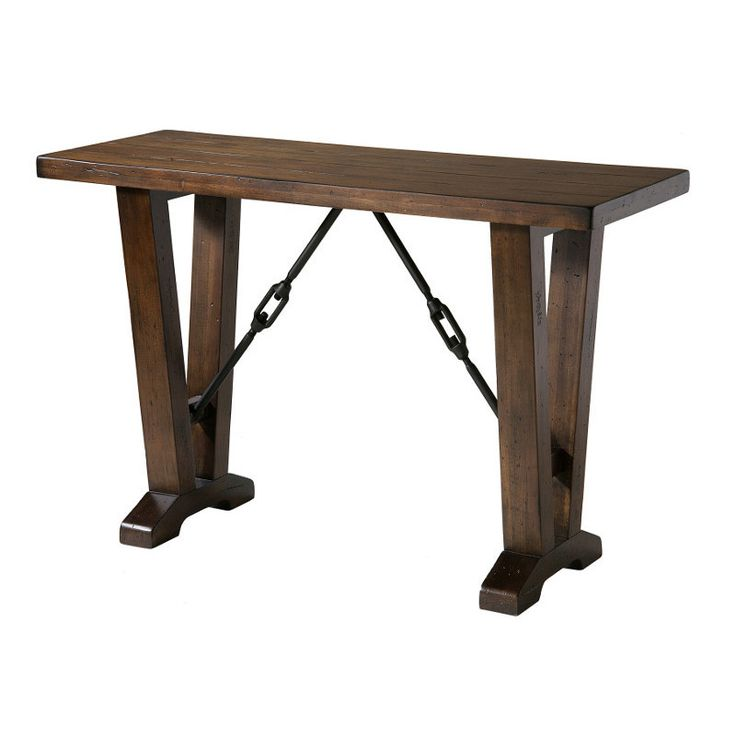 The modern industrial design of the Westport Collection complements both casual and upscale eclectic decor. Interlocking metal stretchers distinguish the Westport group. A planked top is complemented by a Cherry finish with moderate distressing.