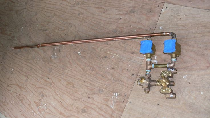 Shower mixing valve and shut off valves for wall and ceiling shower head circuits.