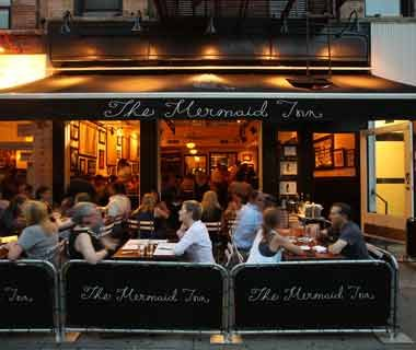 Mermaid Inn, NYC. Greenwich Village, East Village, and Upper West Side. stiff drinks and oysters are the house specialty. Happy Hour: Sunday, 5 p.m. to 7 p.m.; Monday–Saturday, 5:30 p.m. to 7 p.m.