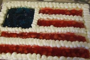 WAVE YOUR FLAG CAKE (Jello with sliced strawberries & blueberries, 12oz sliced pound cake, fresh strawberries, blueberries, and thawed cool whip for topping.