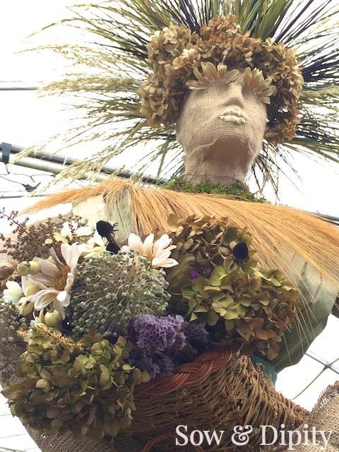 The Harvest Goddess - a celebration of the season made with corn stalks, dried grasses and flowers. A beautiful garden art piece for all you folklore lovers out there!