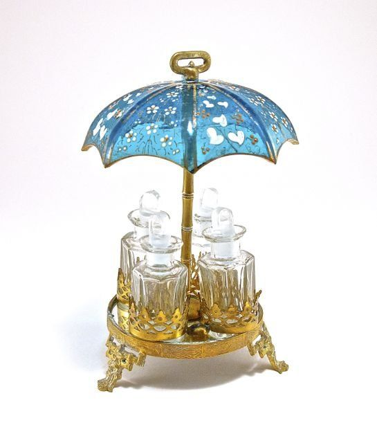 c1900 Bohemian, Palais Royal-style perfume set, 4 bottles and stoppers, clear crystal, metal holder, mirror plateau, enameled blue-green crystal umbrella.