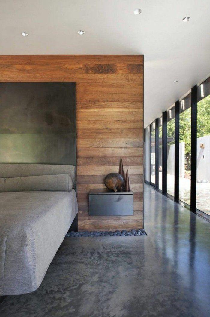 chambre à coucher avec sol en béton ciré gris