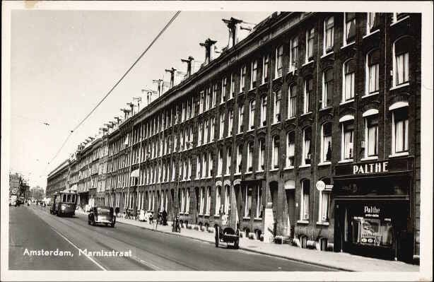 1951. View on the Marnixstraat between the Nieuwe Willemstraat and Brouwersgracht in Amsterdam. The Marnixstraat runs along the western border of the Jordaan area from the Haarlemmerplein to Leidseplein and parallel with the Lijnbaansgracht. The street, which was previously called the Schans, was constructed after 1850. #amsterdam #1951 #marnixstraat