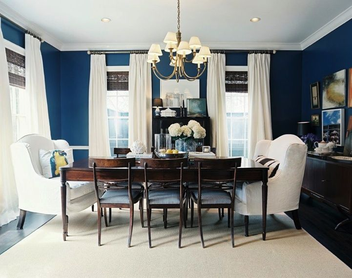 I just love navy blue dining rooms. This one is so pretty. The white wingback chairs, drapes, and match sticks blinds work perfect in this space.