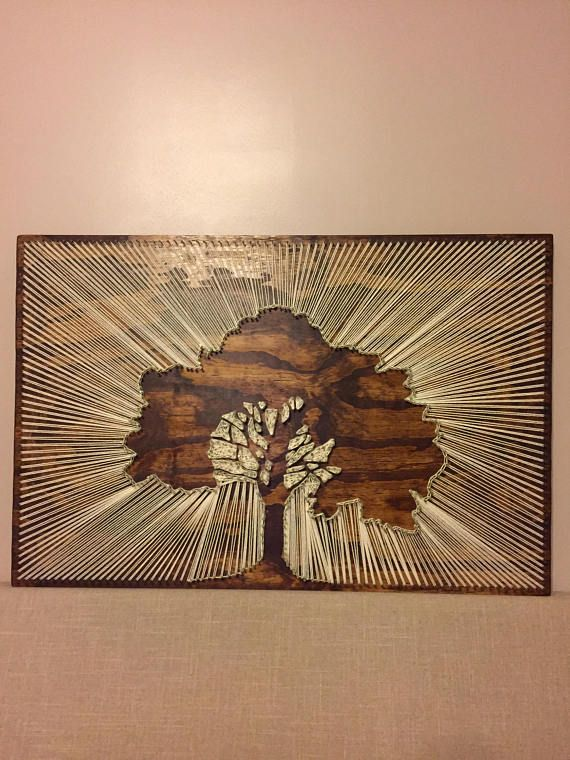 DESCRIPTION This is a negative subject matter image of a big beautiful tree with the sun right behind it. The string mimics a sun ray effect as it is pulled away from the edge of the tree to the border. DIMENSIONS 36 inches x 24 inches (3x2 feet) DETAILS This item is made to order.