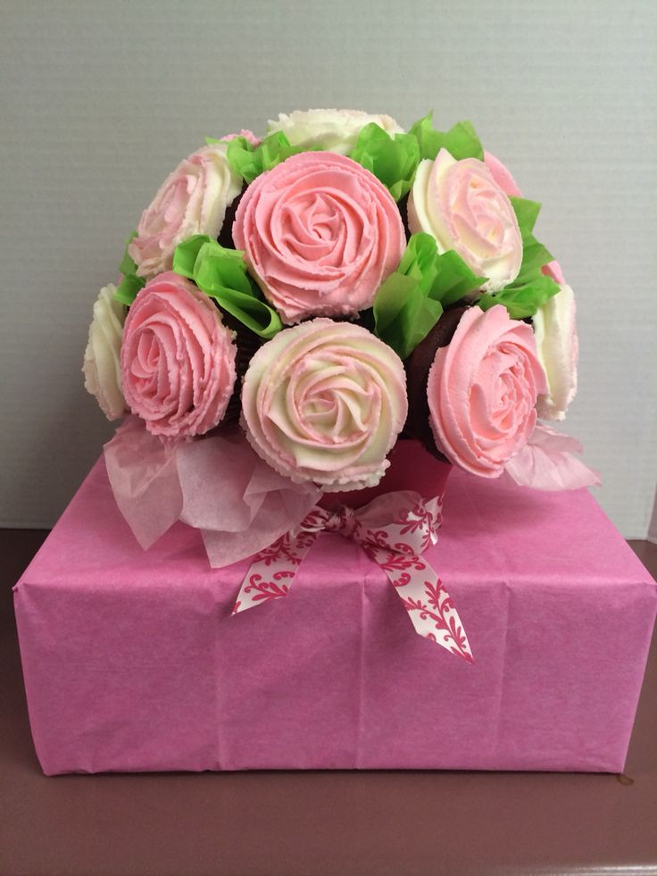 """Cupcake bouquet - I came up a good cheap idea for transporting. Medium FedEx box, cut out an """"X"""" where you push the vase through. Then just decorated with a little tissue paper."""