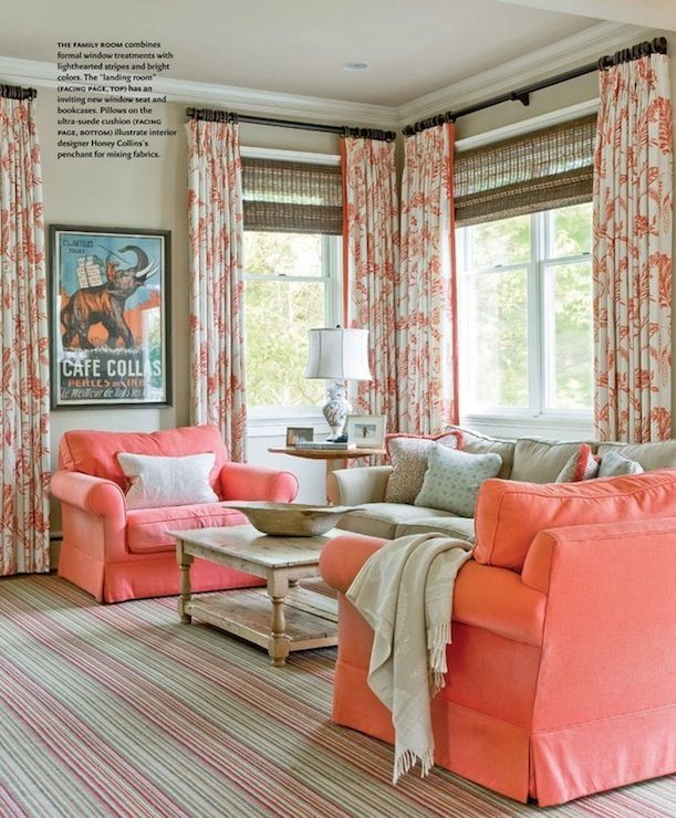 Great coral chairs and curtains, with grey tones throughout...a girly but understated living room.