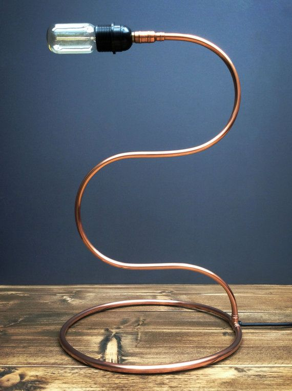 COPPER PIPE RETRO INDUSTRIAL SWAN NECK TABLE LAMP  You are viewing a completely handcrafted table lamp created with 10mm Copper Pipe, If you want something unusual or unique this it the lamp for you. It features a circular base, multi-curved body that leads into a black bulb holder that houses an E27 Edison style filament bulb, to complete the retro look. The wire is a black coloured flex with torpedo on/off switch.  Over time the natural oxidisation of Copper will give it an aged appearance…