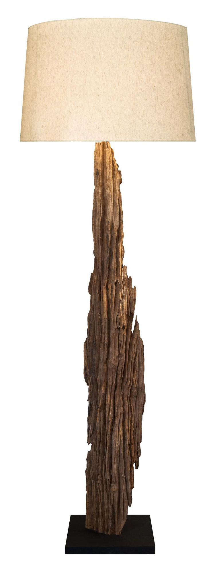 Driftwood Floor Lamp made of natural driftwood with coarse linen shade. | StylishBeachHome.com   Elegance, sophistication, and natural beauty are some of the words that describe this lamp, made of driftwood that were handpicked, then carefully inspected and lined from the bottom up by Scandinavian  designers to highlight its natural beautiful shape.