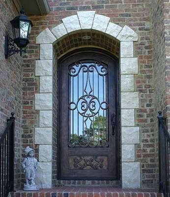 Who said a single door entry way can't be fun?  Design your own wrought iron door, or for a more affordable option- choose from our stock iron doors! iron doors. entryway. curb appeal.  custom doors.