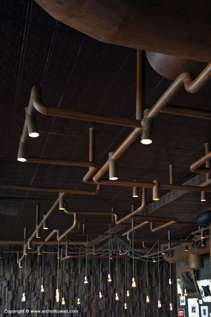 Lighting Grid as pipes. Cocoa Room Restaurant - Kuwait
