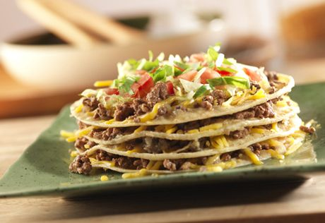 If you're in the mood for a little Tex-Mex, but you're tired of the same old thing, try these simple enchilada stacks. They're fun and flavorful, and best of all, they're ready in under an hour.