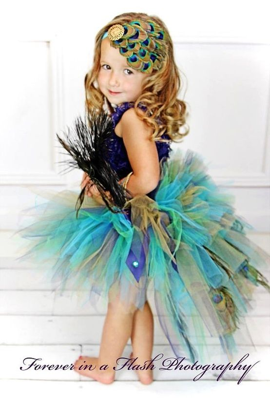 Peacock colors would be beautiful for a flower girl... take this idea, make it longer ...pretty pretty