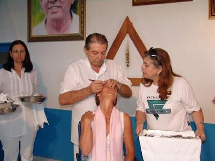 http://travelingtothecasa.com/   John of God in Brazil (João de Deus Brasil) birth name João Teixeira de Faria, a very powerful spiritual healer, known as an unconscious medium, which means that a spirit enters his body. He has been healing for over 50 years, he is now in his sixties, and has been at the Casa de Dom Inacio in Abadiania, Brazil for over 25 years.  There are 33 spirits that work through John of God's body, putting a tremendous strain on him physically.