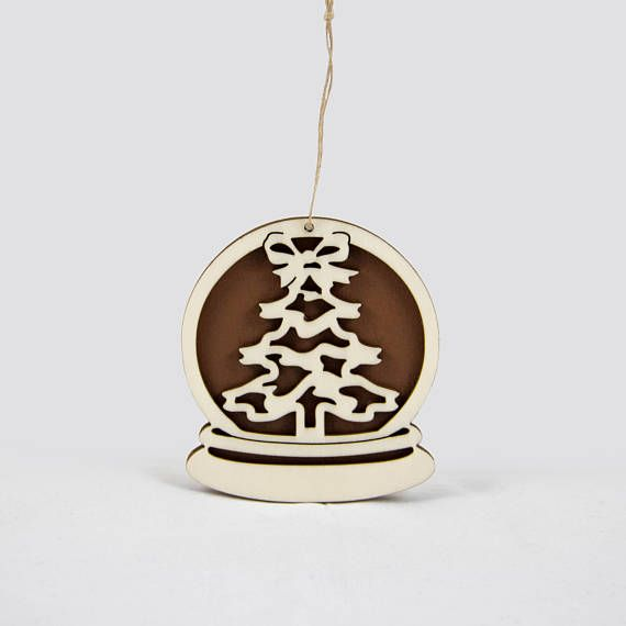 Wooden snow globe Christmas ornament with a Christmas tree