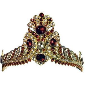 Tiaras of the Iranian Crown Jewels - This exquisitely crafted piece of jewelry, which in essence is a tiara, was used by Fath Ali Shah as a hat decoration, which he wore often on a tall black woolskin hat. This is clearly depicted in several miniature paintings of Fath Ali Shah belonging to this period.
