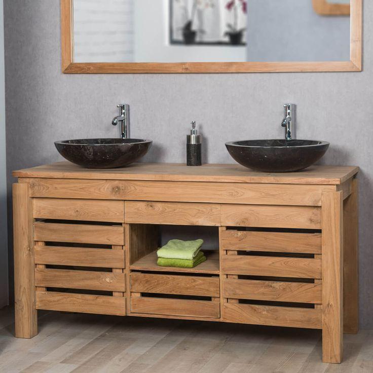 Offrez un look naturel à votre salle de bain en choisissant le meuble double vasque en bois massif teck Zen! Donnez à votre espace bain une touche déco très tendance grâce à ce meuble au design original et chaleureux! Profitez des différents espaces de rangement qu'il propose, notamment une niche pour vos accessoires de beauté, un tiroir pour vos affaires de toilettes et derrière les deux portes ajourées un emplacement pour vos serviettes! Longueur : 145 cm Hauteur : 75 cm Profondeur : 55 cm
