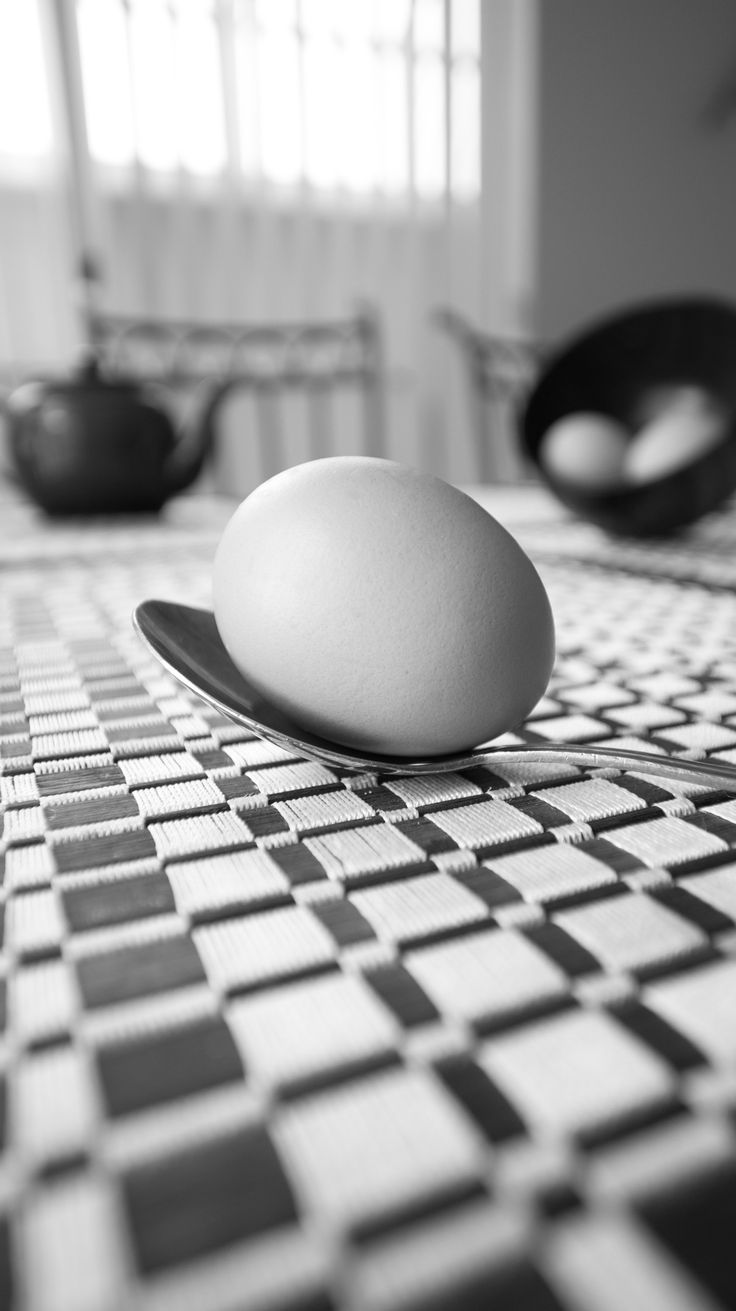 L1M2AS1 Still Life Breakfast. ISO200 16mm f/3.5 1/40th sec Nikon D7100. Sooo... I decided to simplify. Here is an egg. :) I like that the pattern of the placemat emphasised the dof. Spot healing used on egg blemish. Tripod with 2s timer.