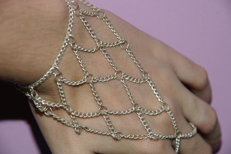 Chain Mail slave bracelet: http://www.mariannedepierres.com/store-2/sundry/