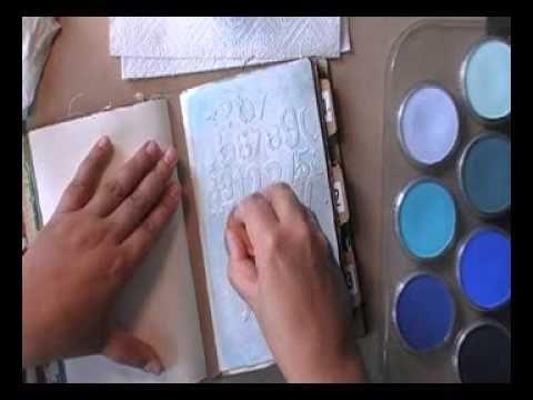 Pan-Pastel-resist (English version). mit Modelierungspaste als Resist-Medium, dann Pan Pastels (Pastgelltöne) + Airbrushfarben aufgesprüht, mit Feuchttuch überflüssige farbe entfernen, und zum Schluss nach Wunsch Patina o.ä.