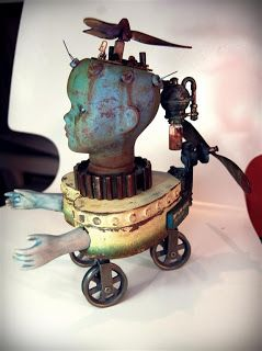 Andy skinner altered doll flying machine...Hi Tracy, I see you like this one, too. I'm thinking of a whole genre of dolls with wheels. Pamela