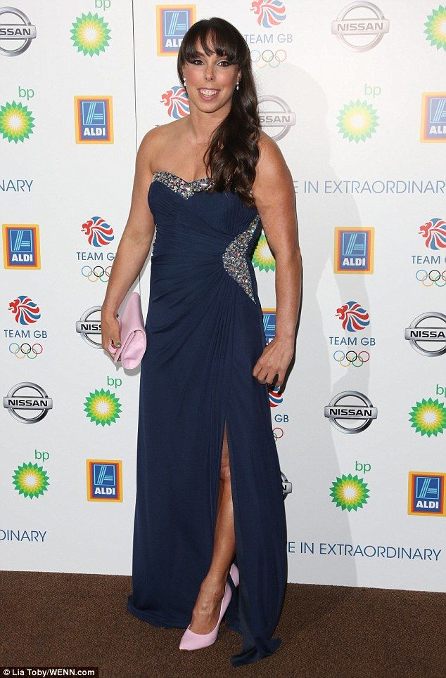 Showing what she's got: Retired Olympic gymnast Beth Tweddle went for glitzy glamour in a strapless navy blue dress with a skirt slit