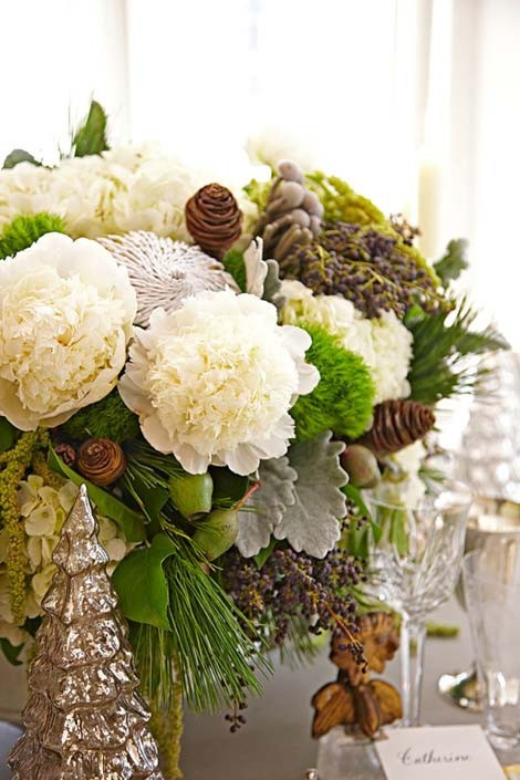 winter arrangement with pinecones and pine boughs