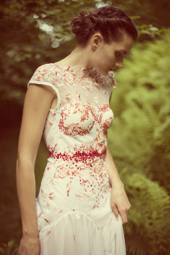 Beautiful lace dress with red embroidery