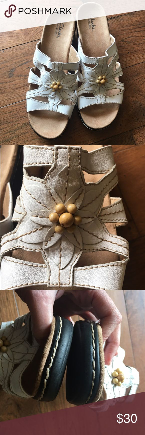 Like New Clarks Sandals Like New Off White Clarks Sandals!! No foot molding due to never wearing. Shoes are in perfect condition Leather upper with Floral detail Clarks Shoes Sandals
