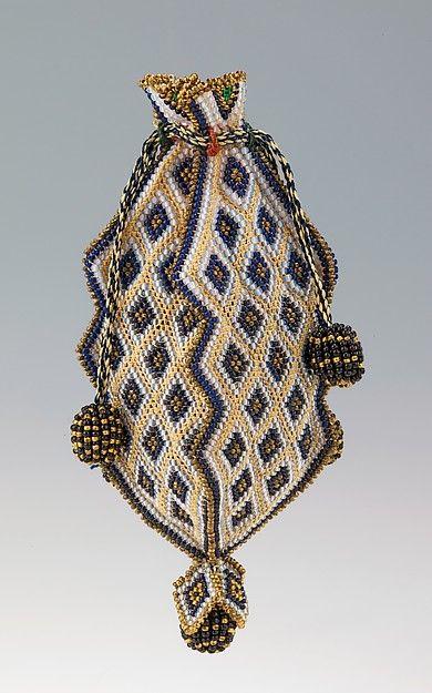 Reticule Date: 1818–30 Culture: Mexican Medium: glass, silk Dimensions: 4 3/8 x 1 1/2 in. (11.1 x 3.8 cm)