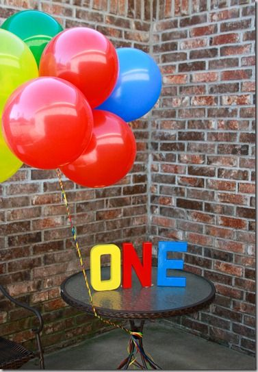 JD 1st Birthday Photo Inspiration // love the balloons and painted ONE letters!