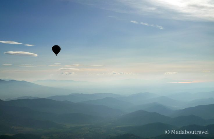 Riding a hot air balloon over la Garrotxa, one of my favourite parts of Catalonia www.madaboutravel.com
