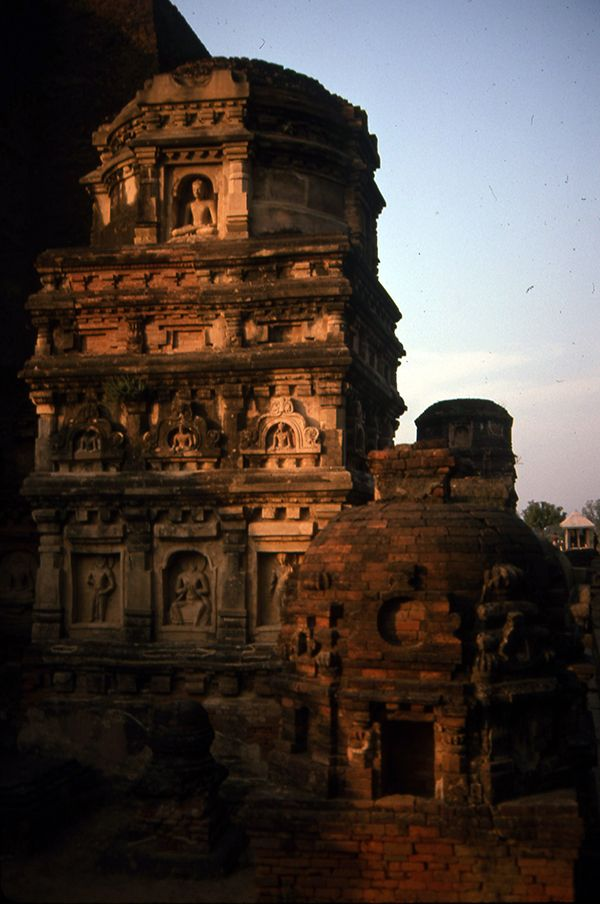 In India relic stupas and temples came of be embellished with a myriad of Buddhist images stucco images from Nalanda.  These sculptures may reference the Buddhist pure lands where a host of enlightened deities reside.