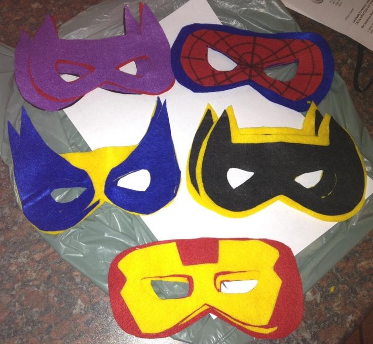 Homemade superhero masks - it was surprisingly easy!  Spiderman, Batman, Wolverine and Iron Man (And random purple girl)
