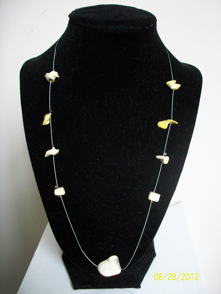 Single strand wire necklace with suspended yellow shells - $15