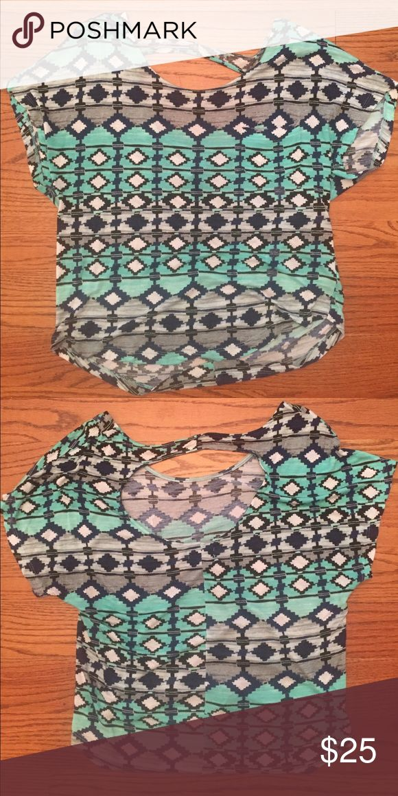 Blue Aztec patterned top with cut out in the back Blue and green Aztec type print top, super comfy. No trades! I'm open to negotiations and questions!! Kirra Tops Tees - Short Sleeve