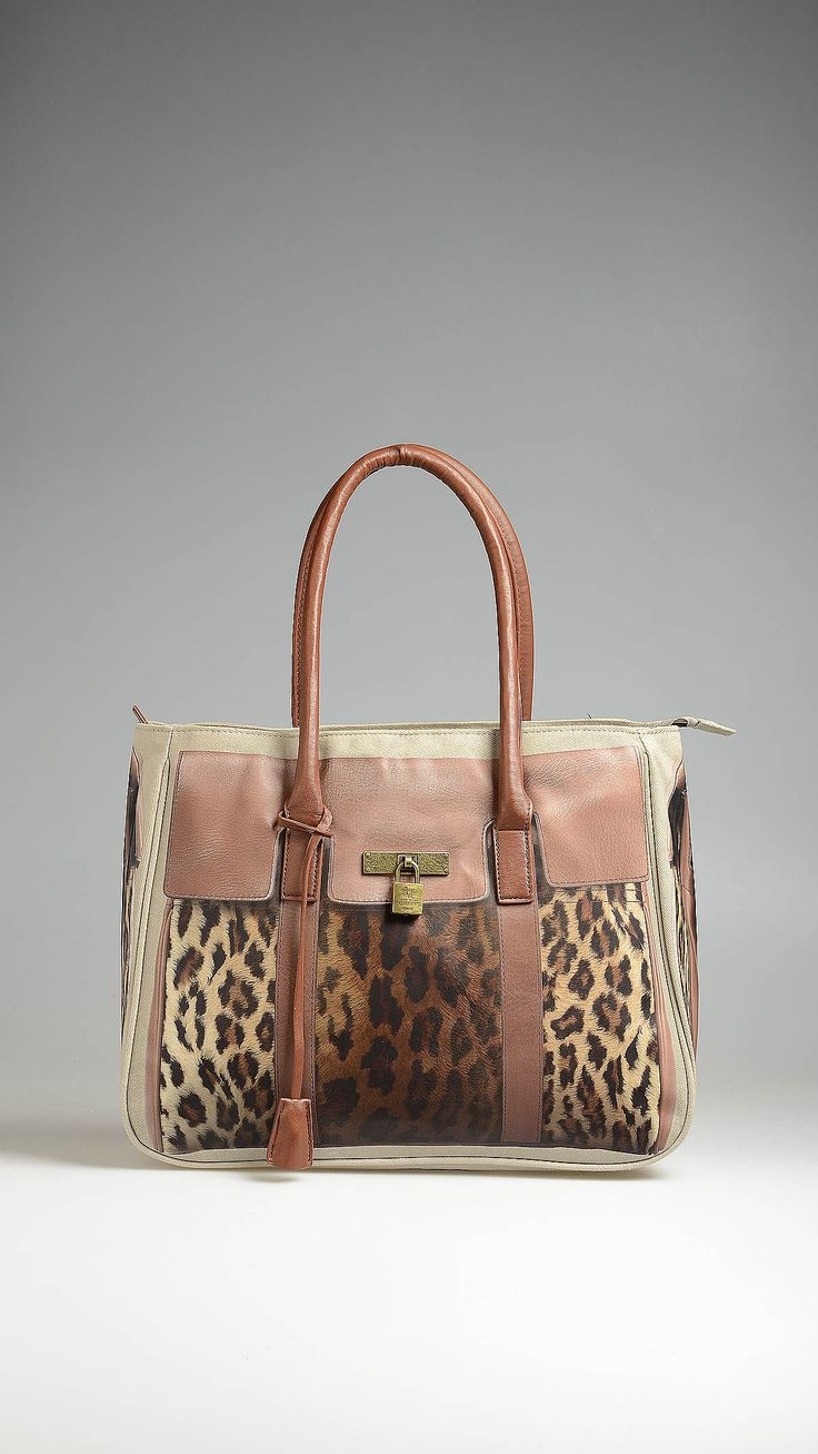 Pomikaki animal print tote bag, two leather handles, metal hardware, zip closure, two inside pockets, inside keyring, metal studs, scarf to be tied to the handles, 15.4 x 11.9 x 6 inch - 39 x 30 x 15 cm.