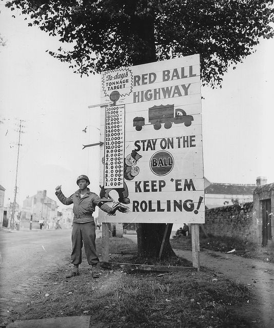 Red Ball Express, Corp. Charles H. Johnson, September 1944, Normandy. (Click through to a great French WWII flickr stream PhotosNormandie.) / Corp. Charles H. Johnson (Police Militaire) veille à la bonne progression des convois.