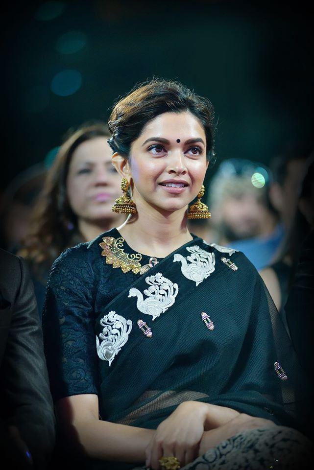 Deepika Padukone in a swan border black saree and blouse. Love her statment jhumkas. Indian celeb fashion.